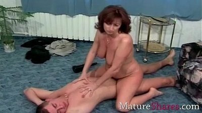 Grandma with giant natural tits teaches hairy mature how to handle a meat pole