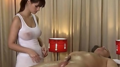 Massage Rooms Rita oils up her huge juicy breasts on a big throbbing cock