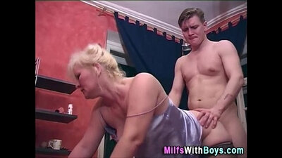 Blonde mature bimbo gets her holes polished in doggy style