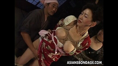 Japanese MILF uses pussy through corset and bra