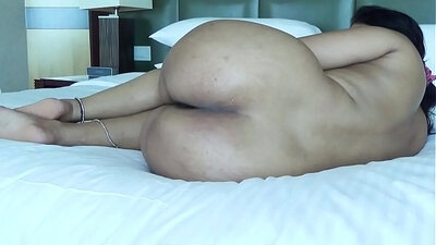 Big ass centerfold spreads legs wide and gives her guy a titjob