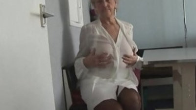 Attractive Granny in short skirt panty taunts showing off round pussy lips