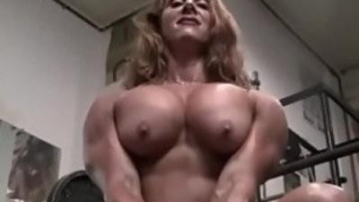 Sexy crimson Headed Female Bodybuilder Muscle