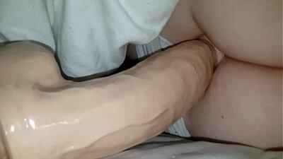 Angry boy toys wife while husband sleeps