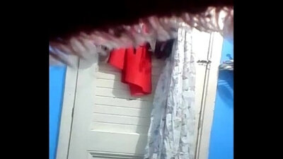 Hidden cam caught my cousin masturbating by the window in the woods