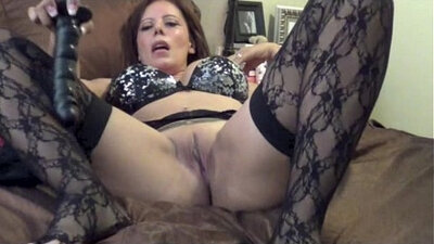 Big bottomed super sexy MILF in black stockings fucks her arse with toy