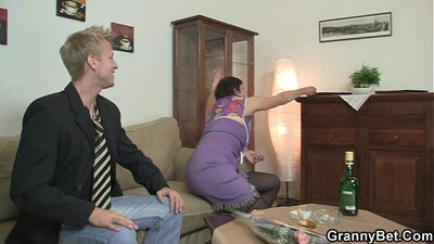 Mom gags after riding cock