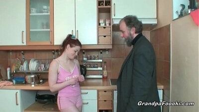Redhead housewife gives a handjob to a boss