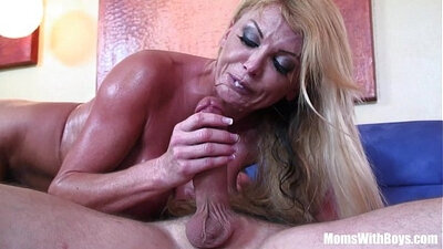 Blond housewife in sexy lingerie gives nice blowjob on the couch