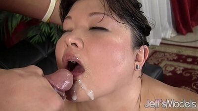 Cute Asian chick eating fat cock in parking lot