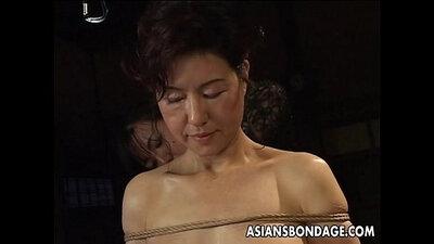 Stuffed up asian babes worship bondage scene