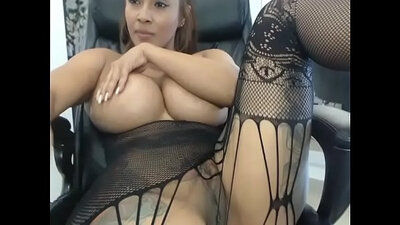 Busty slut in sexy black dress stretches pussy